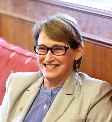 Principal Suzanne Fortier (sofa) cropped- Owen Egan